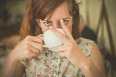 depositphotos_74203777-Woman-drinking-coffee-and-swearing